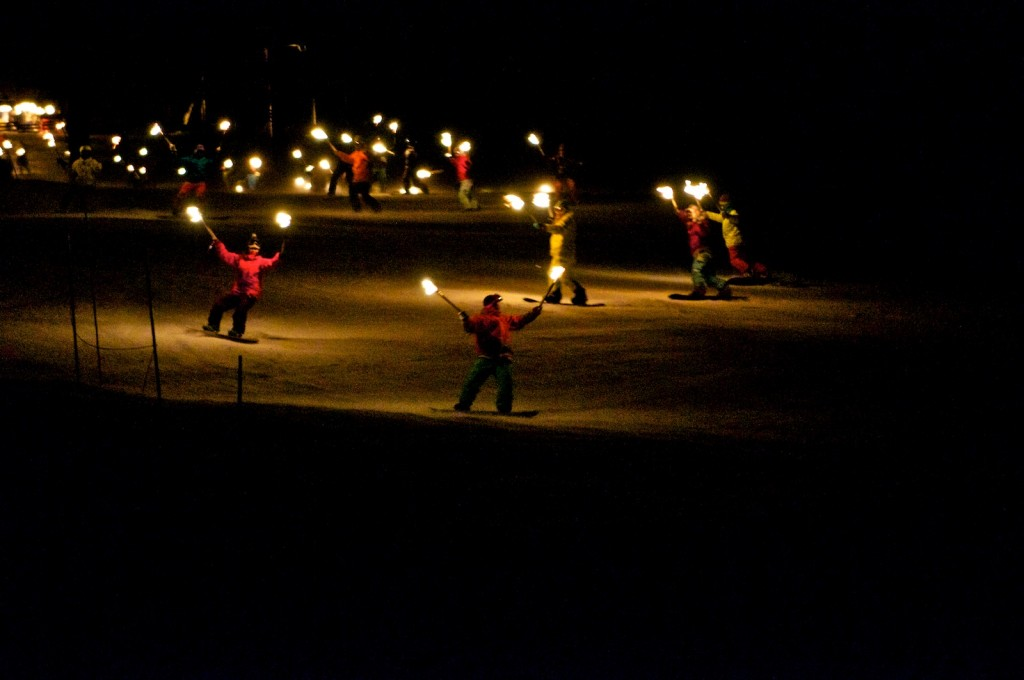 Snowboarders with their flaming torches