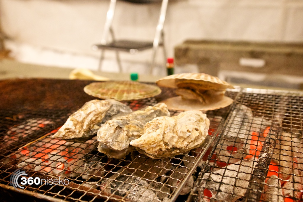 Amazing oysters from Nemuro in Eastern Hokkaido roasting on the charcoal BBQ