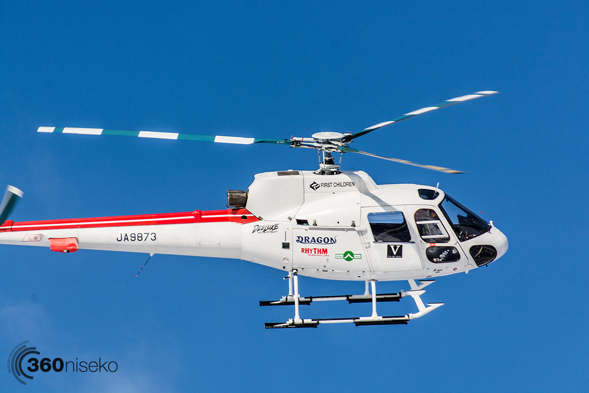 The Hokkaido Backcountry Club chopper coming into land at the Black Diamond Tours office, 13 February 2014