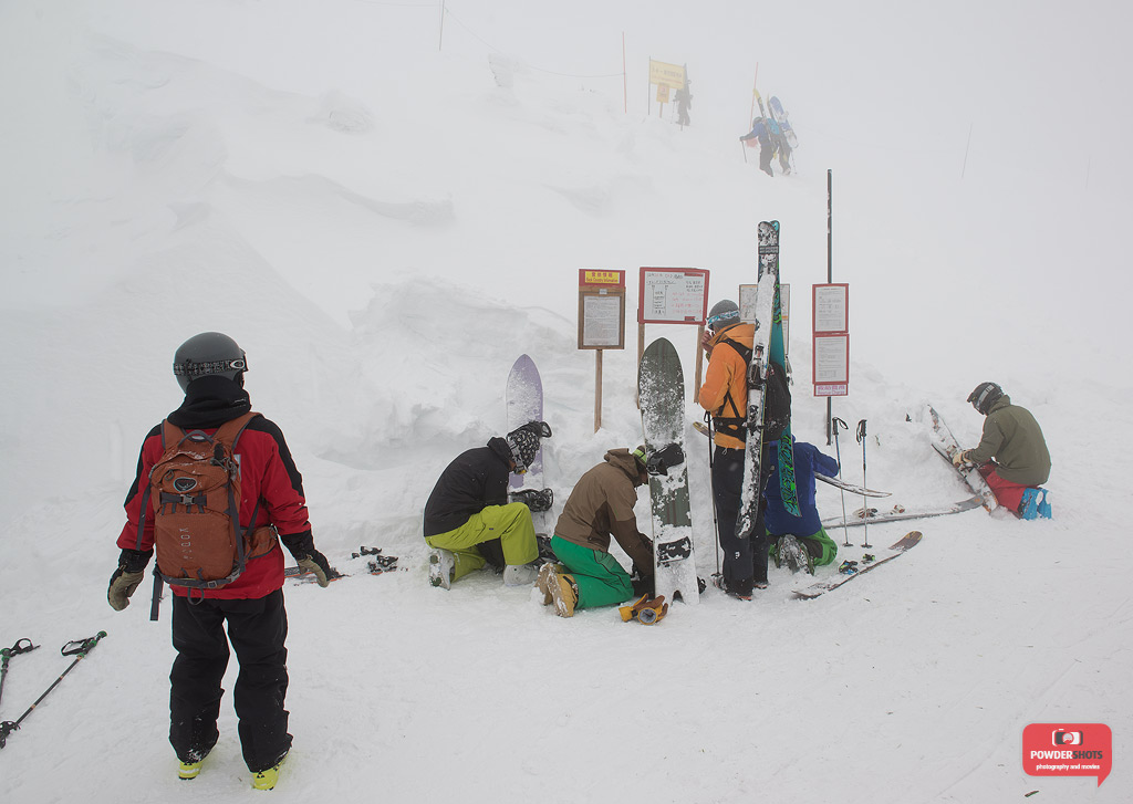 Reading the avalanche report at the top of King #4 Lift, 26 December 2013