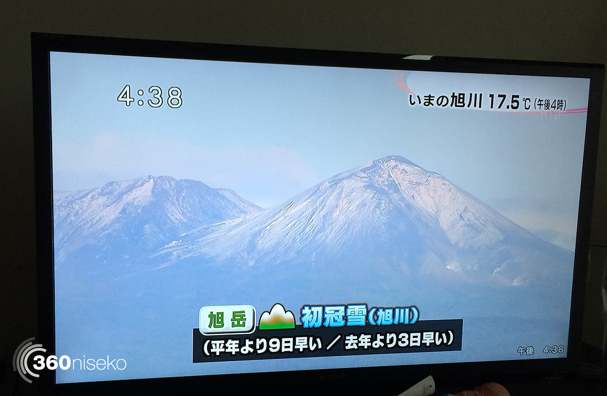 Aerial short of Mt.Asahidake covered in the first snowfall of the 2014-15 season, 16 September 2014