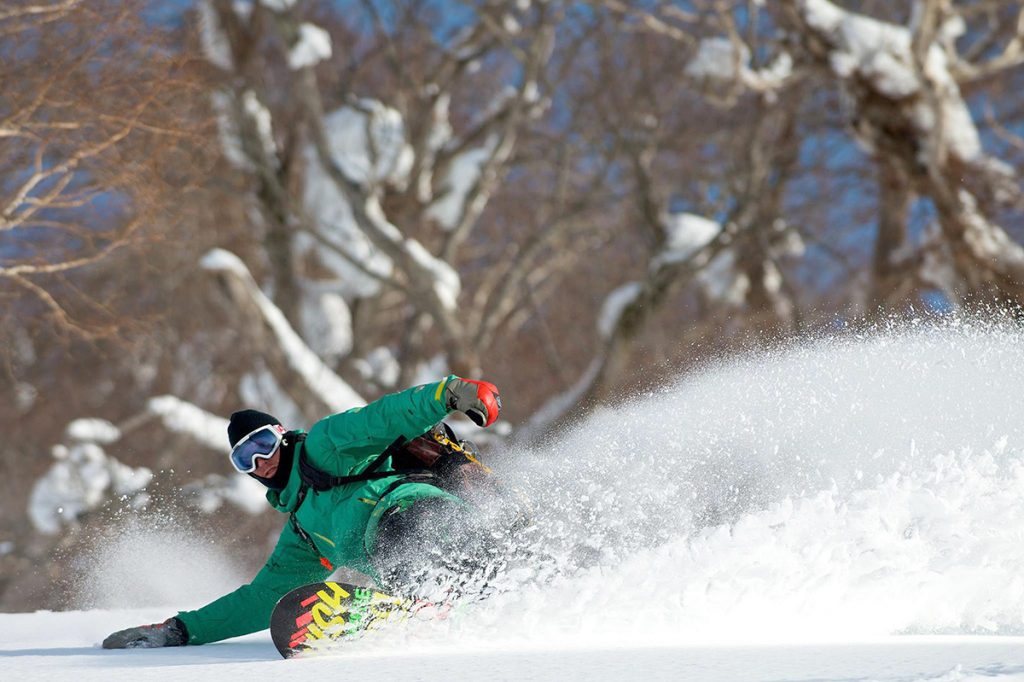 Sam snowboarding down Mt.Yotei, March 2014